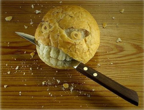 Knife Biting Bread