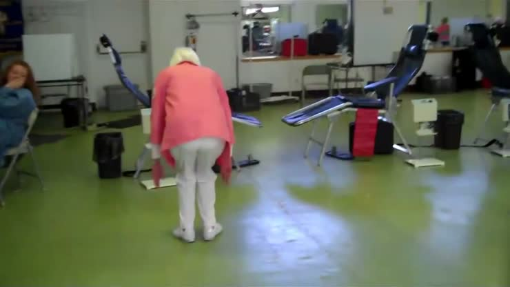 An old lady does a double back flip